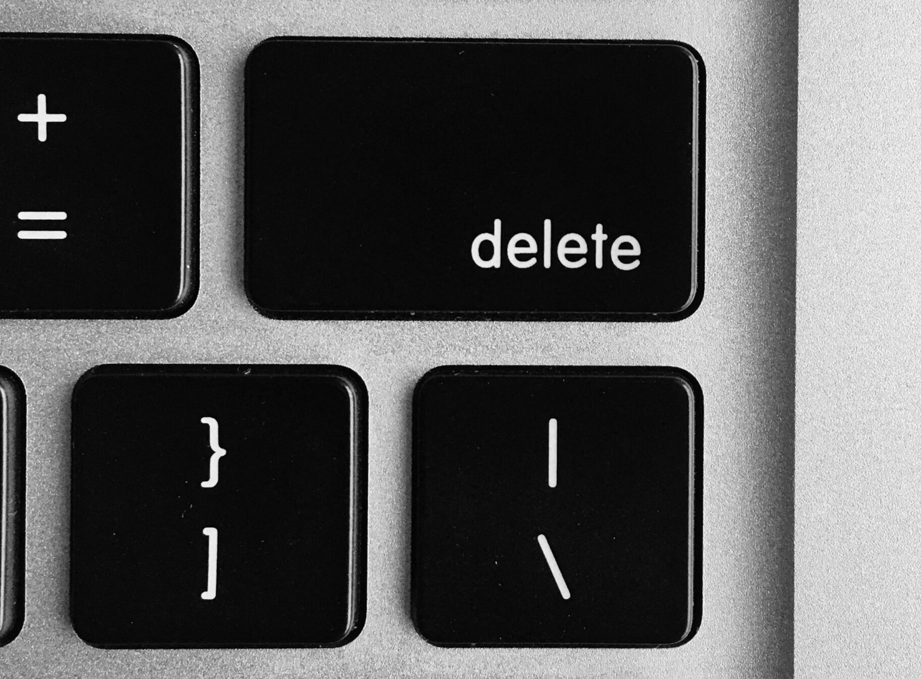 selective focus photo of black and white delete, enter, power button, and F12 computer keys
