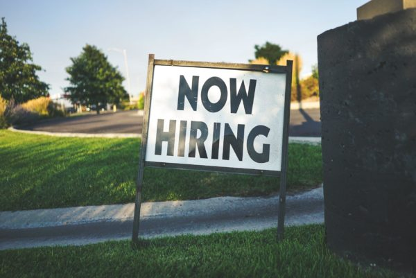 white and black now hiring signage