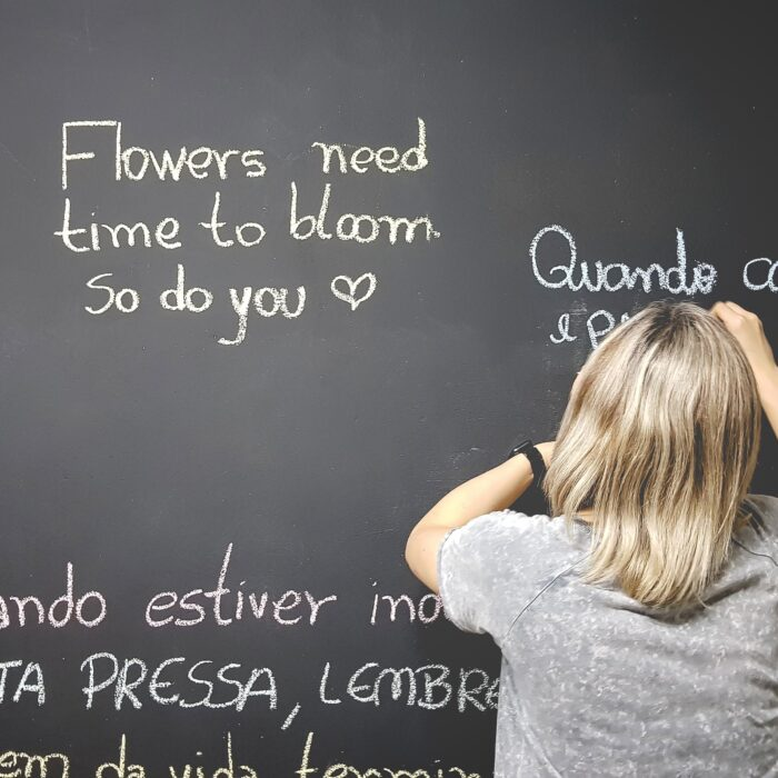 unknown person writing on chalkboard
