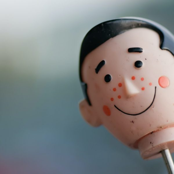 selective focus photography of doll head