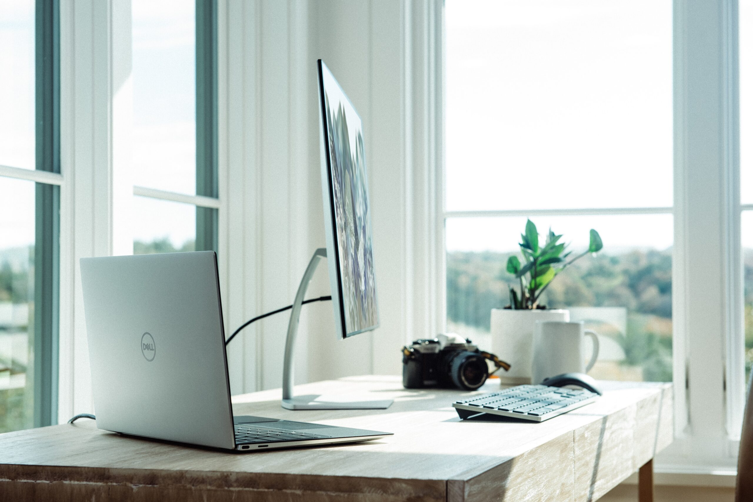silver laptop on white table