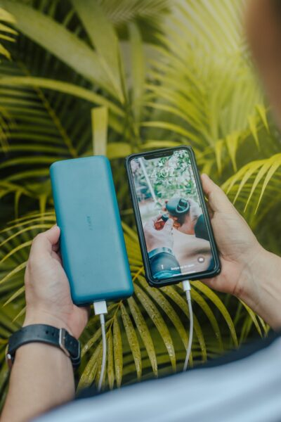 Hand on smartphone and powerbank